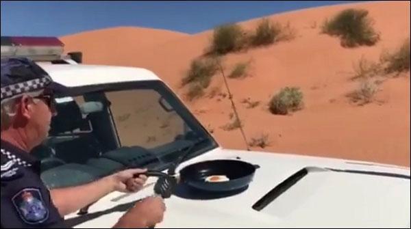 Hot Summer In Australia Police Officer Demonstrated Fry An Egg On Car Bonnet