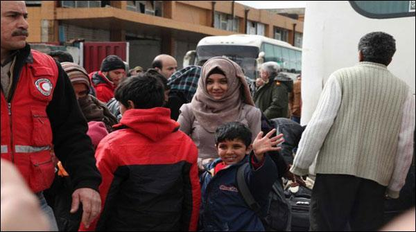 Syrian Government And Rebel Agreement Fighters And Civilians Evacuated From Homs