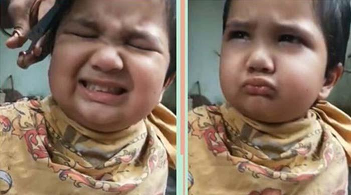 بال کٹواتے ہوئے بچے کی دلچسپ ویڈیو وائرل