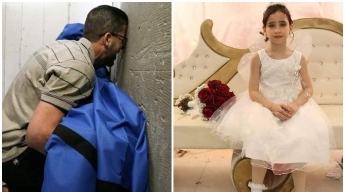 اسرائیلی بمباری میں شہید 12 سالہ بچی کی لاش ہاتھ میں اٹھائے بھائی کی روتی تصویر وائرل