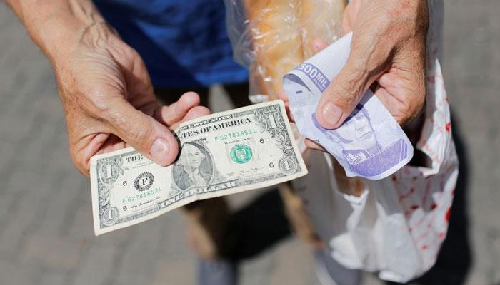 اس عمل سے وینزویلا میں کاروباری اداروں اور بینکوں میں صرف اکاؤنٹنگ آسان ہوگی—فوٹوبشکریہ رائٹرز
